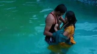 Lovers hot romance in swimming pool