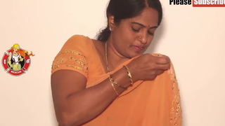Mother wearing a yellow saree, video