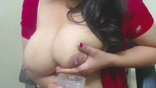 Anu Bhabhi loves thither milk her tits in a glass